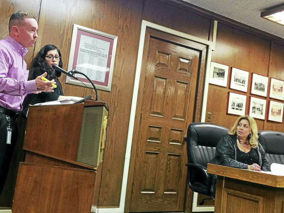 West Haven Director of Finance Kevin McNabola, far left, and Revenue and Asset Management Director Leslie Naizby, answer questions about the tax lien sale from the City Council, including Councilwoman Stacy Riccio, D-4. Photo: Mark Zaretsky - New Haven Register