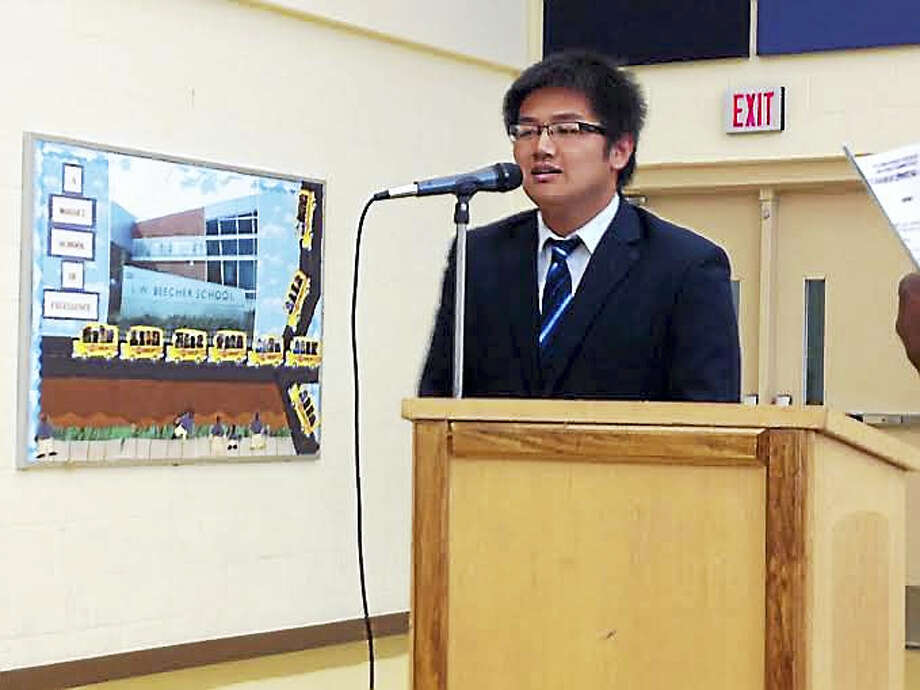 Kiet Ho, a Gates Millennium Scholar from Metropolitan Business Academy, addresses the Board of Education. Photo: Brian Zahn — New Haven Register