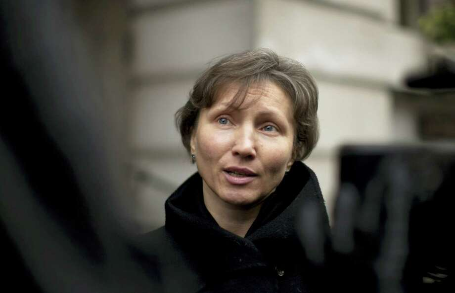 In this Thursday, Dec. 13, 2012 file photo, Marina Litvinenko, the widow of former Russian intelligence officer Alexander Litvinenko, speaks to the media as she leaves at the end of a pre-inquest review at Camden Town Hall in London. On Thursday Jan. 21, 2016, British judge Robert Owen will release the long-awaited findings of a public inquiry into the killing of Litvinenko — and is likely to point a finger at elements in the Russian state. Photo: AP Photo/Matt Dunham, File   / AP