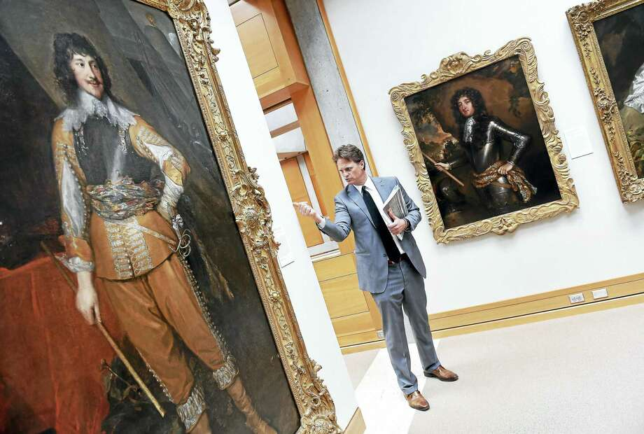 George Knight, principal with Knight Architecture, leads a tour of the Yale Center for British Art in New Haven. Knight is referring to the new, edgeless linen backdrop behind the painting. Photo: Arnold Gold — New Haven Register