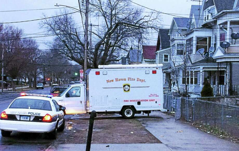 Fire investigators are trying to figure out what sparked a two-alarm house fire at 425-427 Howard Ave. early Monday, March 14, 2016. A police officer who responded to the fire was taken to the hospital with smoke inhalation. Photo: Wes Duplantier — New Haven Register