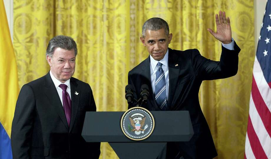 President Barack Obama, right, stands with Colombian President Juan Manuel Santos. Photo: File Photo   / AP