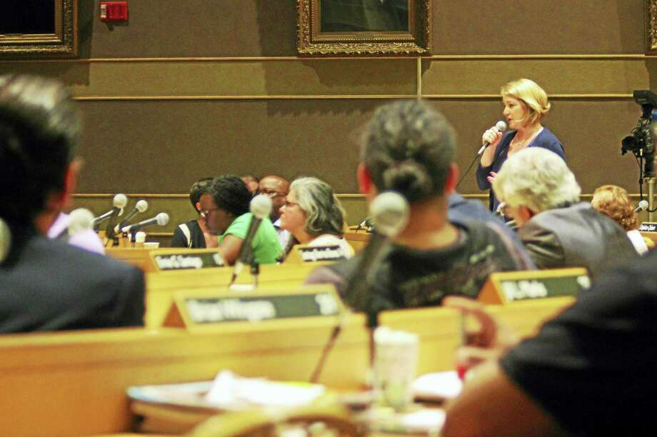New Haven Alder Anna Festa, D-10, rises to speak in opposition of the Strong School project amid lengthy discussions by the Board of Alders during its meeting Monday at City Hall. Photo: Esteban L. Hernandez — NEW HAVEN REGISTER