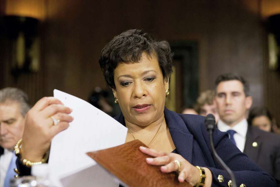 Attorney General Loretta Lynch prepares to testify on Capitol Hill in Washington on March 9, 2016 before the Senate Judiciary Committee hearing. Photo: AP Photo/Andrew Harnik   / AP