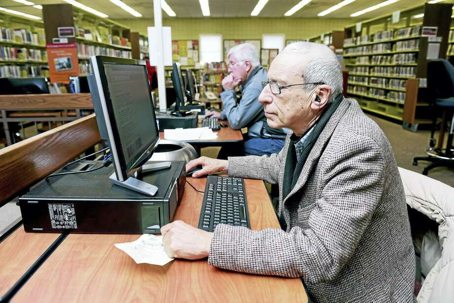 Mike Goodwin of East Haven uses a public computer at the Hagaman Memorial Library in East Haven Tuesday. Photo: Arnold Gold — New Haven Register