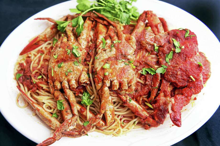Spaghetti with crab sauce made by Chef Giuseppe Fappiano at Ferraro's Market on Grand Avenue. Photo: Arnold Gold — New Haven Register