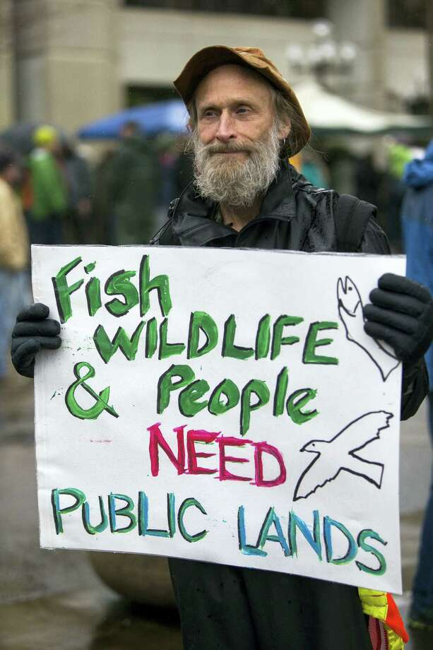 John Perry holds a poster during a rally against the occupation of the Malheur National Wildlife Refuge by Ammon Bundy and his armed followers, while joining the rally at the Federal Building in Eugene, Ore., Tuesday, Jan. 19, 2016. With the armed takeover of the national wildlife refuge in southeastern Oregon in its third week, Bundy and his armed group are still trying to muster up broad community support, so far without much luck. Photo: Andy Nelson/The Register-Guard Via AP / The Register-Guard