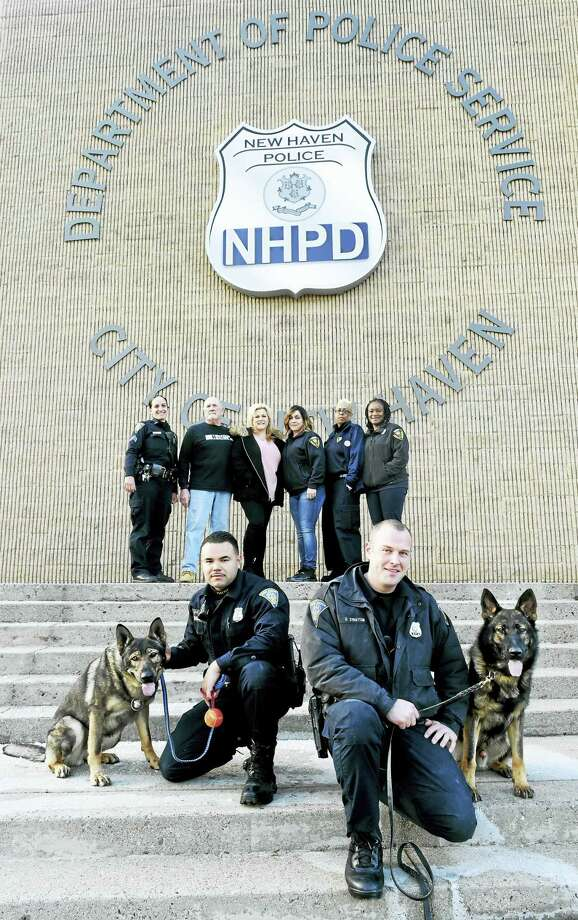 Rear, from left, New Haven Police Department District Manager and K-9 Supervisor Sgt. Renee Dominguez; Ken Mackenzie and Dana MacKenzie of MacKenzie Machine Inc. of New Haven; NHPD dispatchers of Team 911 Cathy Sargent, Joy Dunston and Kendra Payne. Front row, from left, New Haven police canine Ax with his handler, Patrolman Martin Feliciano and Patrolmen Dave Stratton with his police dog Atos. Photo: Peter Hvizdak — New Haven Register   / ©2016 Peter Hvizdak