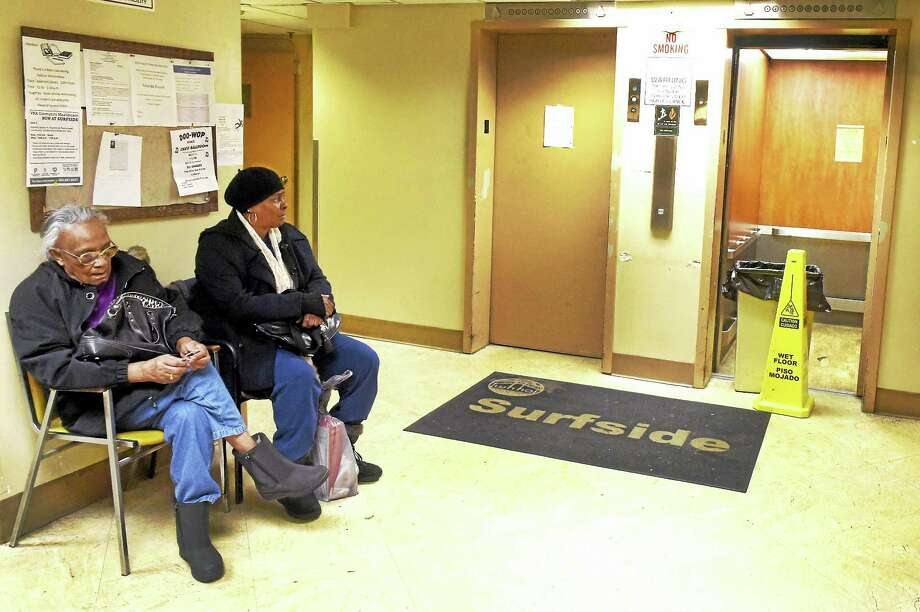 People wait to take the elevator at the Surfside housing complex in West Haven Tuesday. At the time of the photo, neither elevator was working. Photo: Peter Hvizdak — New Haven Register   / ©2016 Peter Hvizdak