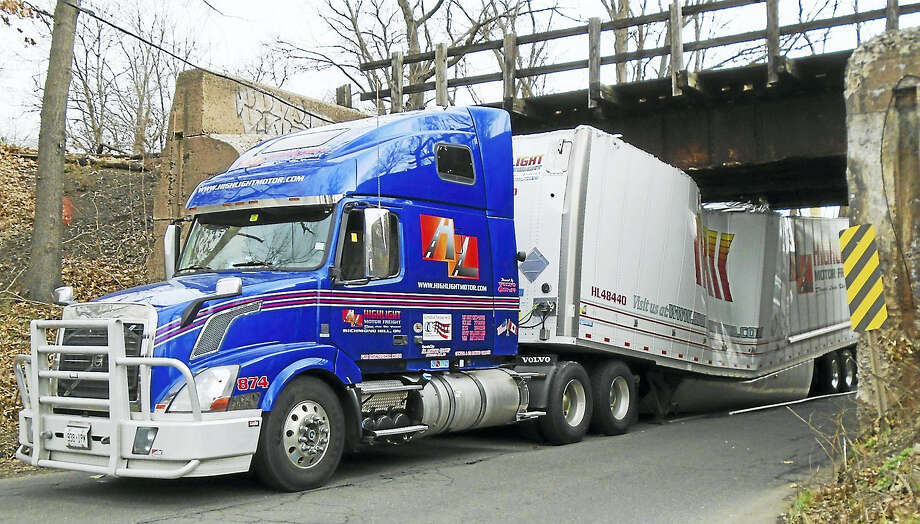 Part of Sackett Point Road was shut down near Universal Drive North early Monday afternoon after a tractor-trailer slammed into a railroad bridge. The truck trailer was damaged but no one was hurt. Photo: Wes Duplantier — The New Haven Register   / Copyright 2009