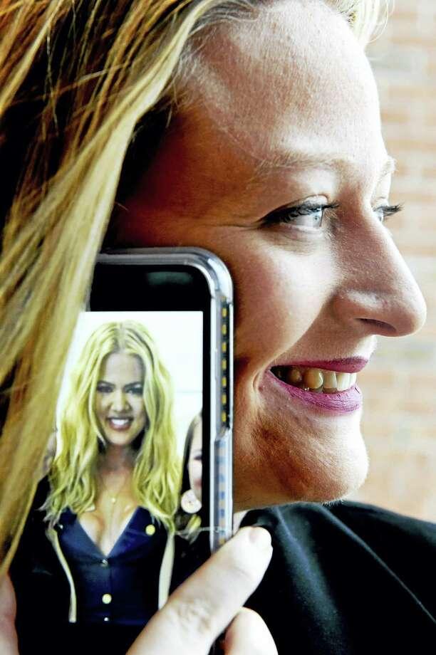 Madison Sparago of Milford holds a photo of Khloe Kardashian on her mobile phone Tuesday. Photo: Peter Hvizdak — New Haven Register   / ©2016 Peter Hvizdak