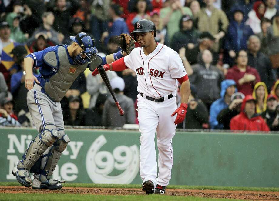Marco Hernandez, right, reacts after he struck out swinging to end Sunday's game against the Blue Jays. Photo: Steven Senne — The Associated Press   / Copyright 2016 The Associated Press. All rights reserved. This material may not be published, broadcast, rewritten or redistribu
