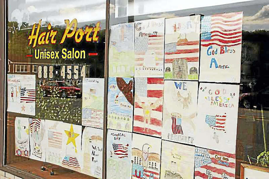 A past year's poster contest entries in a business window in Seymour. Photo: Jean Falbo-Sosnovich - New Haven Register File Photo