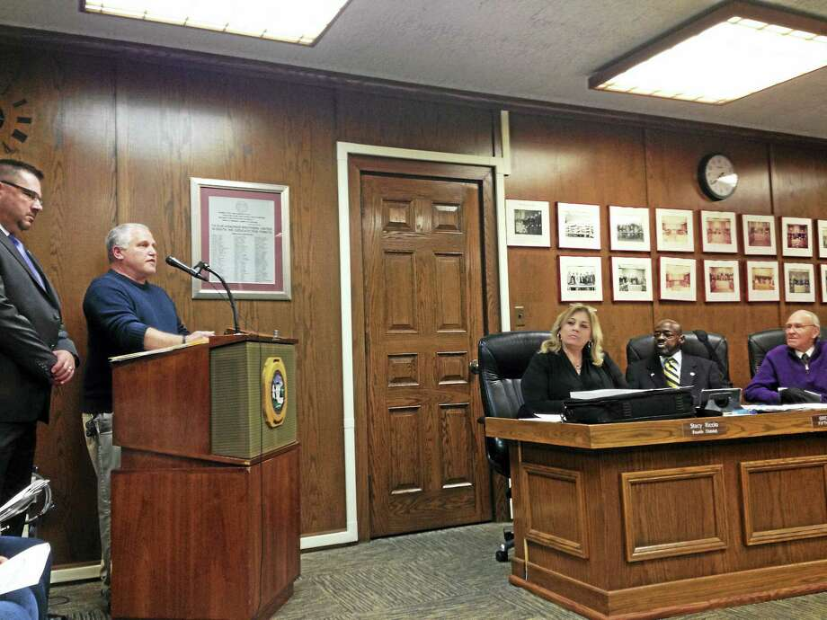 MARK ZARETSKY — NEW HAVEN REGISTER  Deputy Police Chief Joseph Perno, at microphone, and Board of Police Commissioners Chairman Raymond Collins III address West Haven City Council about parking violation fines Monday night. Photo: Journal Register Co.