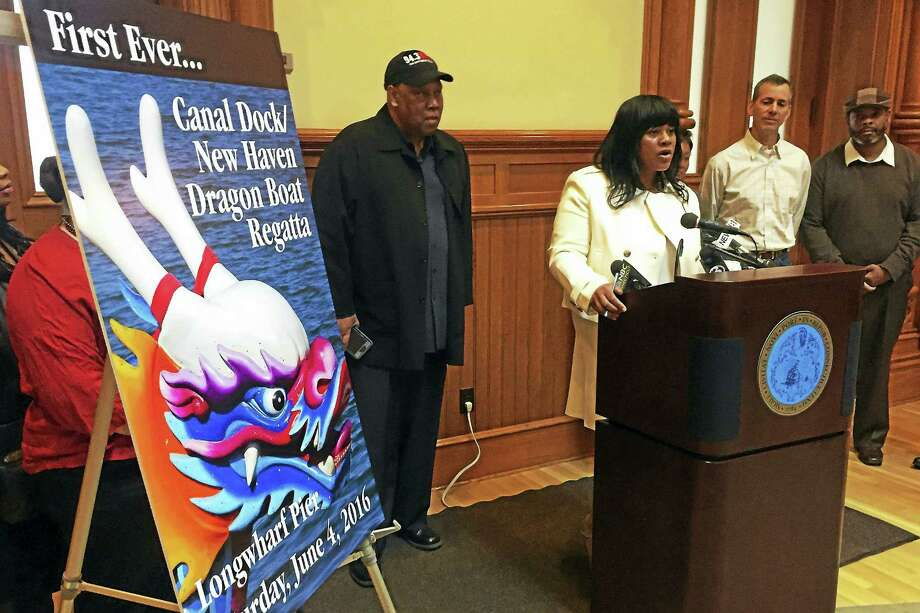 Deputy Economic Development Director Jackie James speaks during a press conference Monday announcing the city is adding a Dragon Boat race to its second annual New Haven Food Truck Festival. Photo: Esteban L. Hernandez — New Haven Register