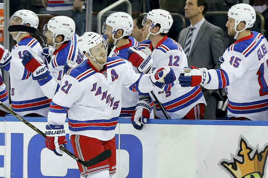 New York Rangers center Derek Stepan (21) is congratulated by teammates after scoring against the Philadelphia Flyers during the third period Sunday. Stepan scored his 100th and 101st career goals. Photo: The Associated Press   / AP