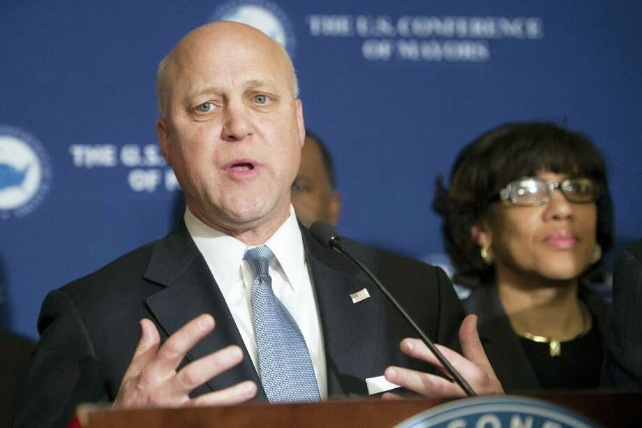 New Orleans Mayor Mitch Landrieu speaks at a news conference during the U.S. Conference of Mayors Winter Meeting in Washington, Wednesday, Jan. 20, 2016. Flint, Mich., Mayor Karen Weaver is at right. Photo: AP Photo/Cliff Owen    / FR170079 AP