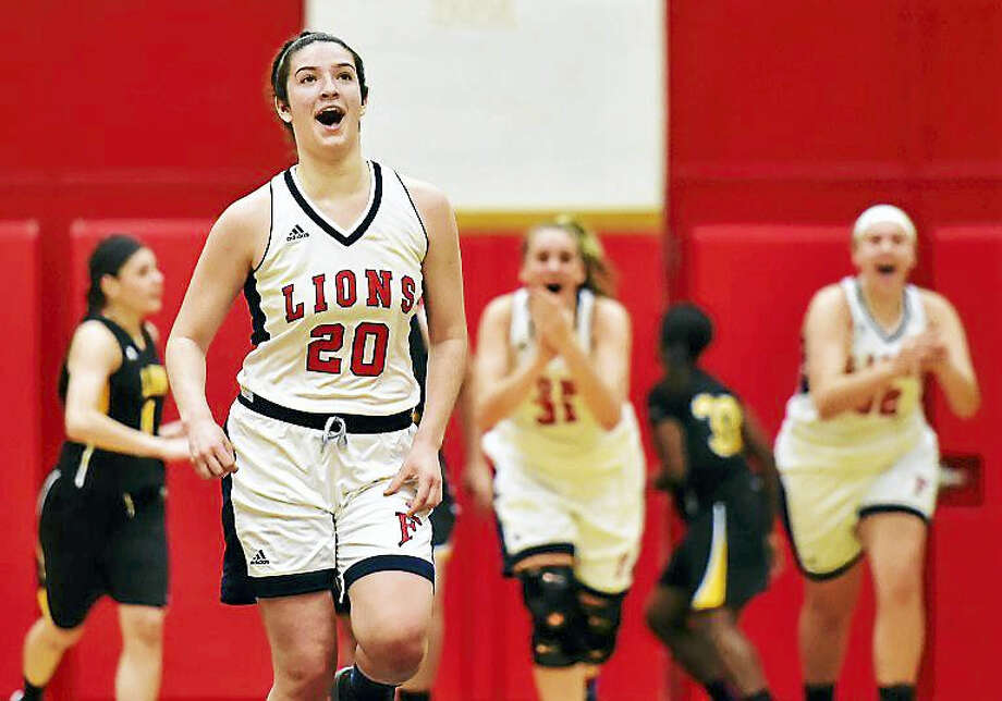Foran freshman forward Jasmine Lord looks up at the scoreboard after hitting a buzzer shot, defeating cross town rival Law 44-43, Tuesday at the Edna L. Fraser gymnasium. Photo: Catherine Avalone — New Haven Register   / Catherine Avalone/New Haven Register