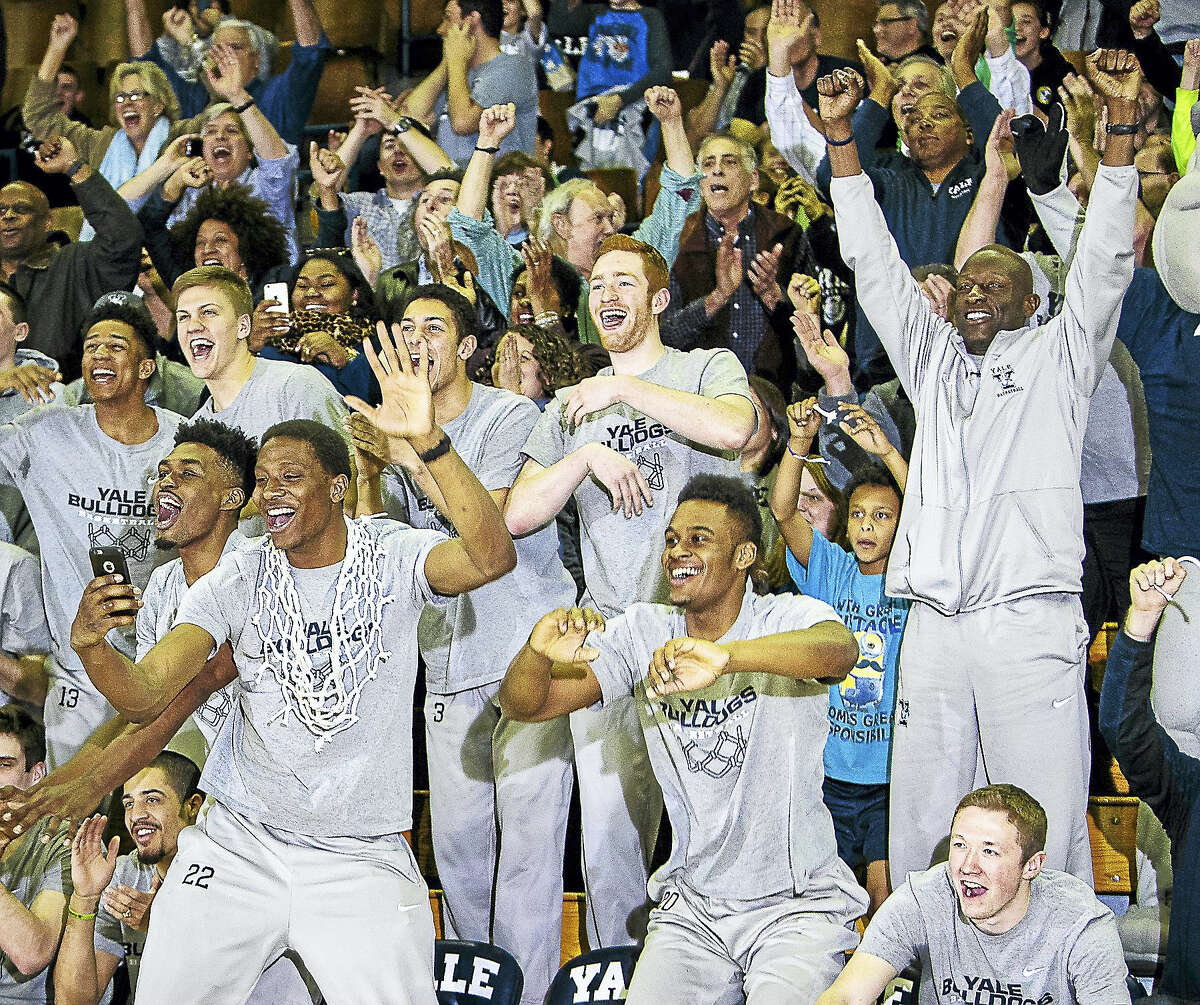 Justin Sears(front center) and the rest of the Yale Bulldogs Basketball team celebrate their NCAA tournament selection in the West region. The Bulldogs will play Baylor in the first round of the NCAA tournament in Providence RI.-John Vanacore/Register