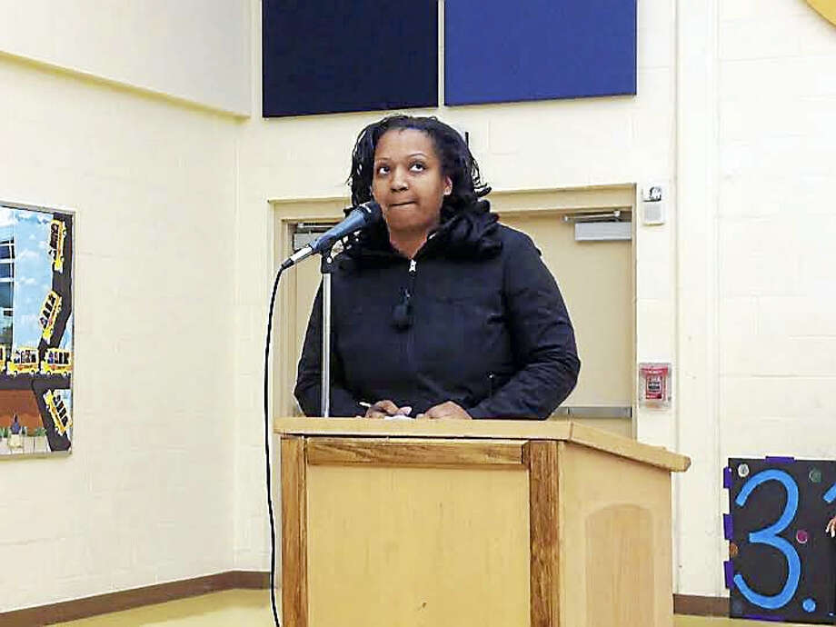 Parent Maria Harris bemoans the quality of guidance departments in the city's high schools, at a Board of Education meeting Monday night in New Haven. Photo: Brian Zahn — New Haven Register