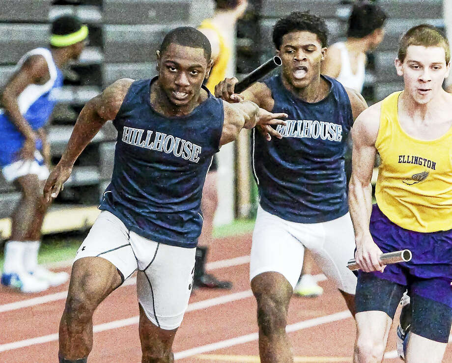 Hillhouse sprinter Gabriel Abdul Karim hands the baton off to to Darius Wise during their second-place finish in the 4 x 200-meter relay in the CIAC Class M State champisonhip. Photo: John Vanacore — New Haven Register   / John Vanacore-Register