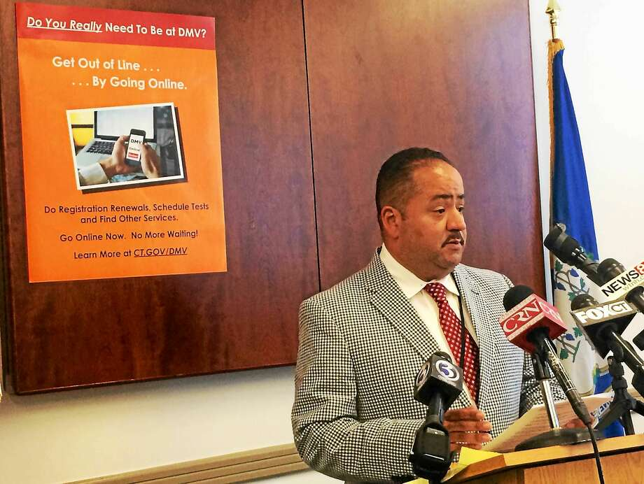 File photo: Andres Ayala Jr. talks in August about the Department of Motor Vehicle's computer upgrade at DMV headquarters in Wethersfield. Photo: (Wes Duplantier -- New Haven Register)
