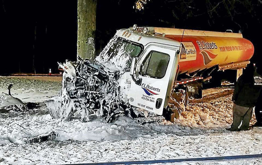 Photo courtesy of Teresa BerryA tanker truck carrying gasoline and diesel fuel crashed into an SUV early Saturday on Route 8 in Litchfield. The tanker didn't spill its load but the front of the cab did catch fire. Photo: Journal Register Co.