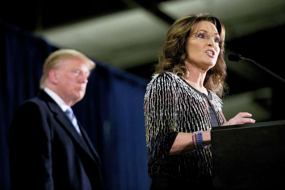 Former Alaska Gov. Sarah Palin, right, endorses Republican presidential candidate Donald Trump during a rally at the Iowa State University on Jan. 19, 2016 in Ames, Iowa. Photo: AP Photo/Mary Altaffer   / AP