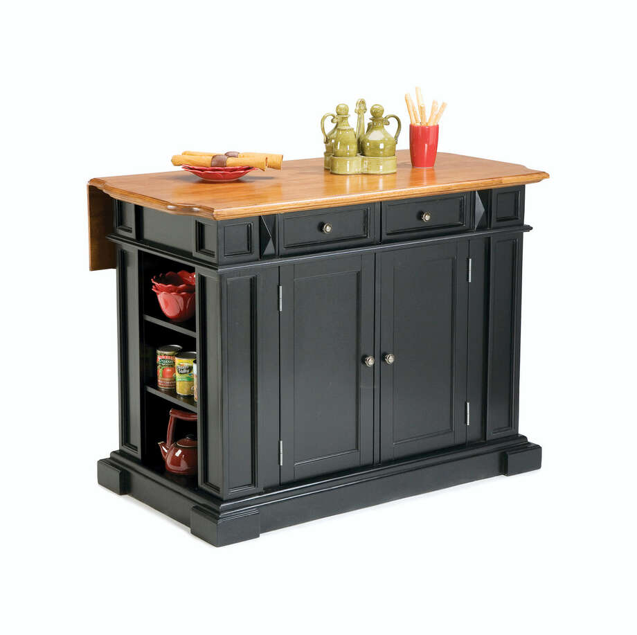 In this photo provided by Houzz.com, a transitional kitchen island or cart in black would be a smart way to introduce the color without committing to more permanent elements like cabinetry. This one from Houzz combines on-trend distressed wood with black. Photo: Houzz.com Via AP   / Houzz.com
