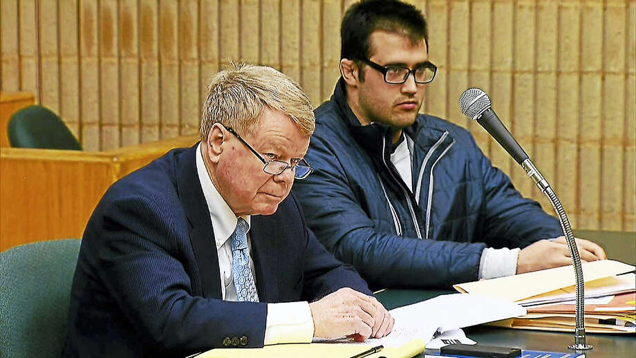 Timothy D. Granata, right, at the defense table with attorney Hugh F. Keefe, of New Haven, was sent Wednesday into state custody for 60 years for killing his mother in their Orange home in 2014. Photo: News 12 CT