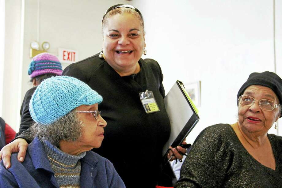 New Haven's Director of Elderly Services Migdalia Castro, center, talks to Barbara Jennings, left, and Shirley McCoy Wednesday at the Atwater Senior Center in New Haven. Photo: Esteban L. Hernandez — New Haven Register