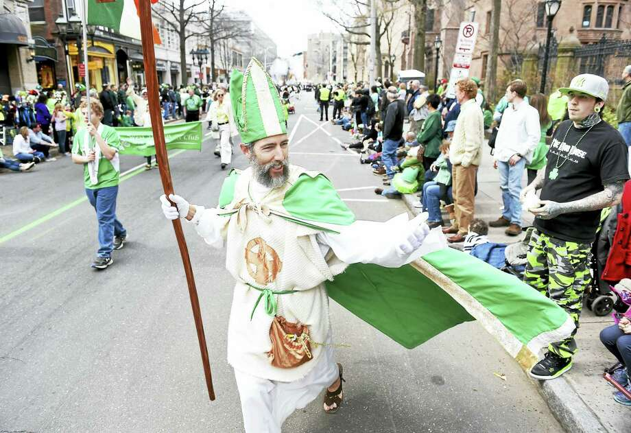 (Arnold Gold-New Haven Register)  Peter Ortoleva of the West Haven Irish American Club, dressed as St. Patrick, mixes it up with the crowd at the annual Greater New Haven St. Patrick's Day Parade on Chapel Street in New Haven. Photo: Journal Register Co.
