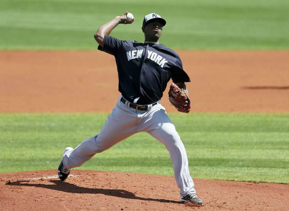 Yankees starting pitcher Luis Severino works against the Rays in the first inning on Saturday. Photo: Tony Gutierrez — The Associated Press   / Copyright 2016 The Associated Press. All rights reserved. This material may not be published, broadcast, rewritten or redistributed without permission.