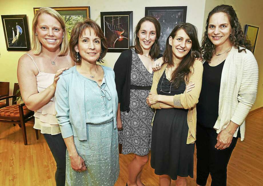 Bonnie Blair, a nurse from Guilford, second from left and Elise Resch, a nurse midwife from New Haven, second from right, are being honored by Hope After Loss with Compassionate Care Awards. Photo: Catherine Avalone — New Haven Register    / New Haven RegisterThe Middletown Press