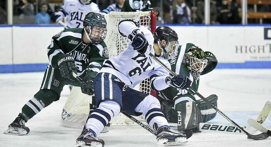 Dartmouth goalie Charles Grant protects the net as Yale's Stu Wilson tries to sneak one past in the third period on Saturday. Photo: Catherine Avalone — Register   / New Haven RegisterThe Middletown Press