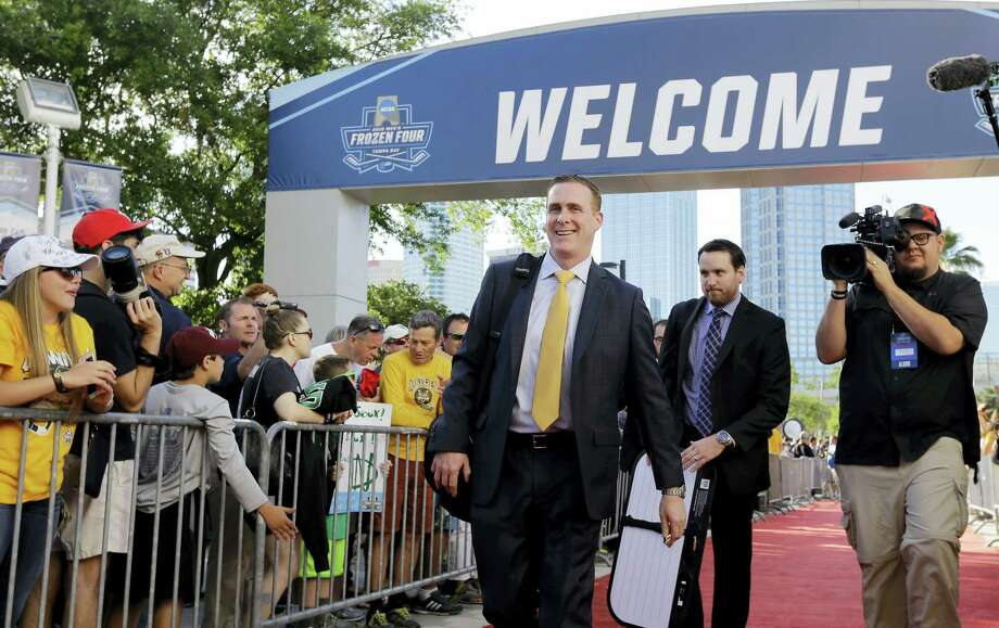 Quinnipiac head coach Rand Pecknold, left, and his fellow coach in ECAC Hockey have worked hard make certain the conference is welcomed in the conversation for college hockey's elite. Photo: Chris O'Meara — The Associated Press   / Copyright 2016 The Associated Press. All rights reserved. This material may not be published, broadcast, rewritten or redistributed without permission.