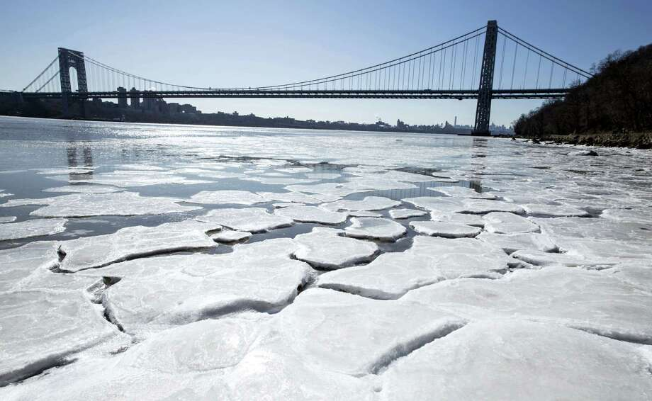 Jim Anness/The Record of Bergen County via AP  The entire Northeast shivered Sunday. Ice begins to form on the banks of the Hudson River in Englewood Cliffs, N.J., as temperatures dove to the single digits this weekend. Photo: AP / The Record of Bergen County