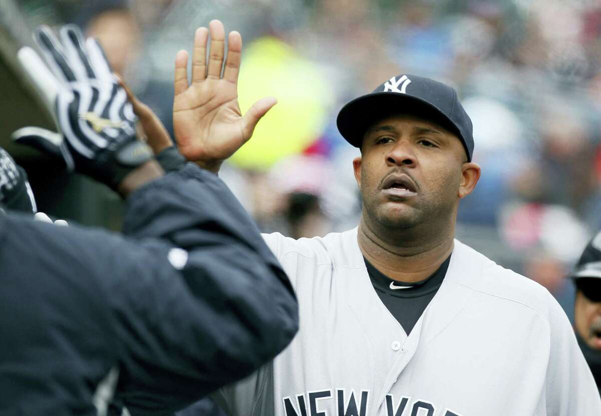 New York Yankees' CC Sabathia is congratulated in the dugout after being pulled from a baseball game against the Detroit Tigers during the seventh inning Saturday, April 9, 2016, in Detroit. (AP Photo/Duane Burleson)