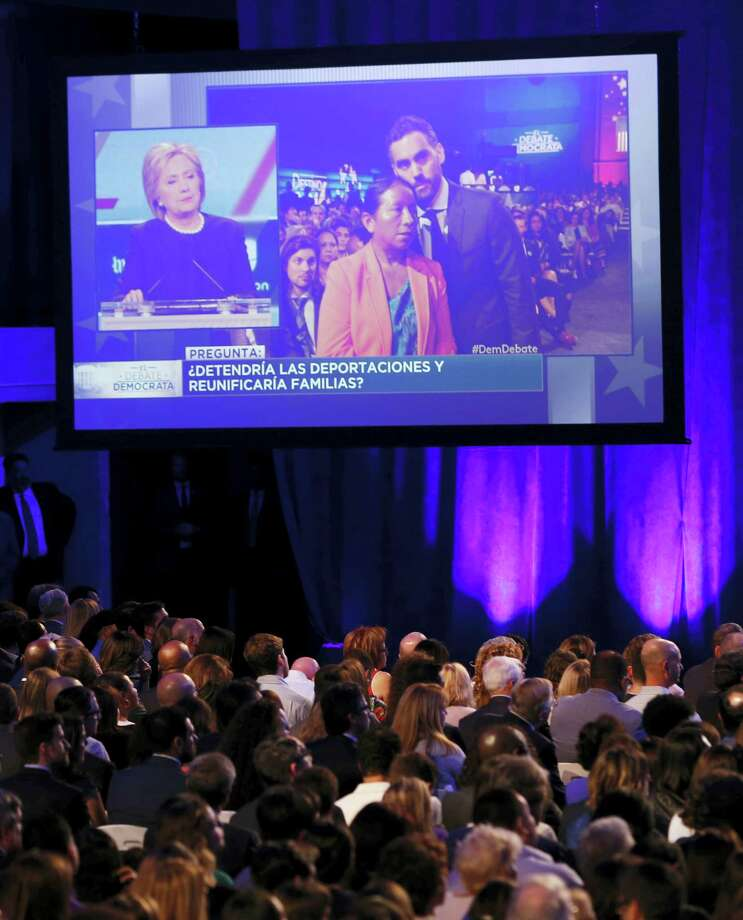 A woman asks a question about immigration and family reunification to Democratic presidential candidates, Hillary Clinton and Sen. Bernie Sanders, I-Vt, during the Univision, Washington Post Democratic presidential debate at Miami-Dade College,  Wednesday. Photo: The Associated Press   / AP