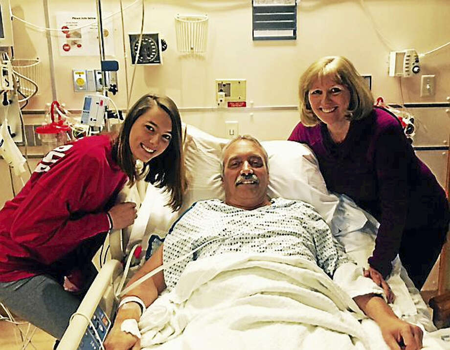 Yale-New Haven Hospital  Patient John Pesavento waits at Yale-New Haven Hospital Sunday morning in anticipation of receiving a new heart with daughter Kristen Pesavento, left, and his wife, Ruth, all from Bridgeport. Photo: Journal Register Co.