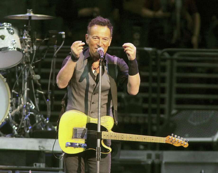 """In this Feb. 12, 2016, file photo, Bruce Springsteen performs in concert with the E Street Band during their """"The River Tour 2016"""" at the Wells Fargo Center in Philadelphia. Springsteen has canceled his concert in North Carolina, citing the state's new law blocking anti-discrimination rules covering the LGBT community. In a statement on his website Friday, April 8, 2016, Springsteen said he was canceling the concert scheduled for Sunday in Greensboro because of the law, which critics say discriminates against gay, lesbian, bisexual and transgender people. Photo: Photo By Owen Sweeney/Invision/AP, File    / Invision"""