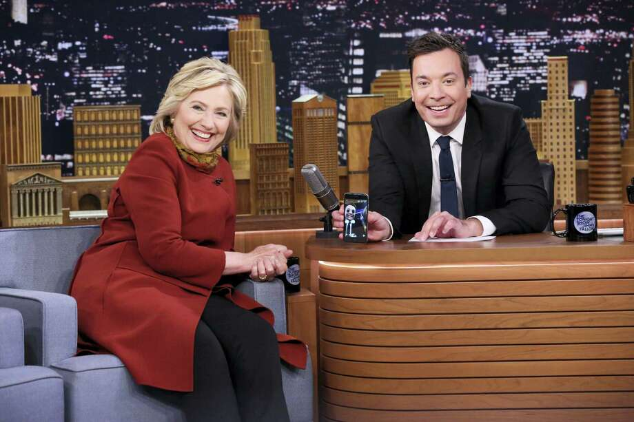 """In this photo provided by NBC, Democratic presidential candidate Hillary Clinton, left, and host Jimmy Fallon take a Snapchat during a taping of """"The Tonight Show Starring Jimmy Fallon,"""" on Jan. 14, 2016 in New York. Photo: Douglas Gorenstein/NBC Via AP   / NBC"""