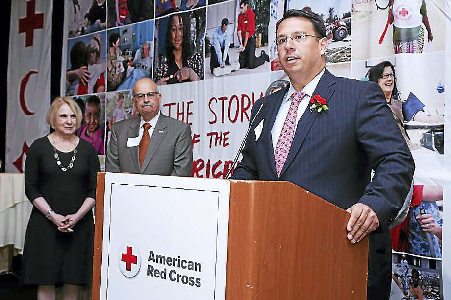 Milford Mayor Ben Blake accepts an award from the American Red Cross naming the city a 2016 Community Resilience Hero. Contributed art. Photo: Journal Register Co.