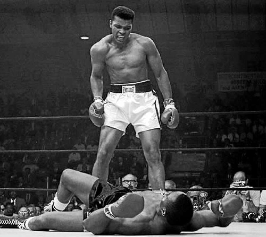 Heavyweight Muhammad Ali defiantly stands over the vanquished Sonny Liston. Photo: ASSOCIATED PRESS FILE PHOTO