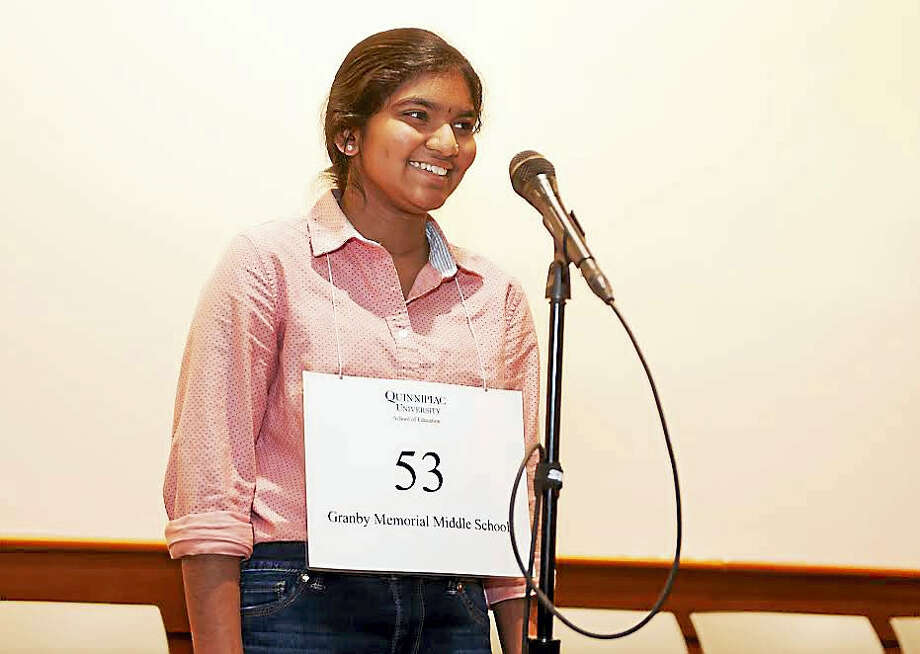 Dwaritha Ramesh, 14, of Granby Memorial Middle School, correctly spells the winning word in the Connecticut Championship Spelling Bee Saturday, March 12, 2016 in the auditorium at the Center for Medicine, Nursing and Health Sciences on Quinnipiac University's North Haven Campus. Photo: Contributed Photo By Autumn Driscoll/Quinnipiac University / (Autumn Driscoll / Quinnipiac University)