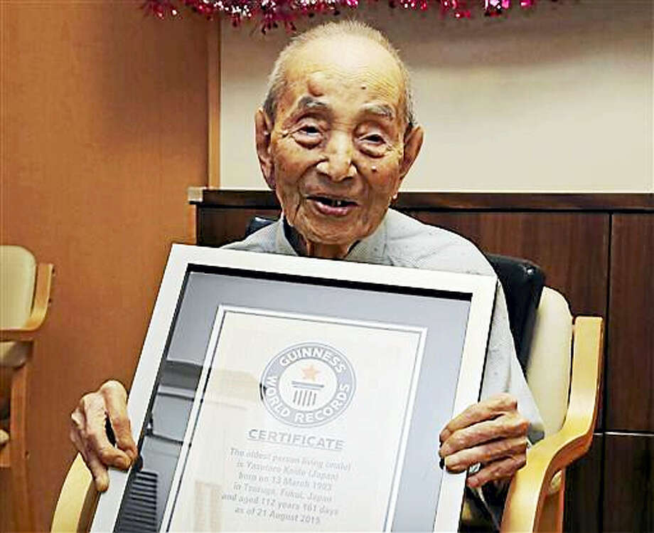 In this Aug. 21, 2015, file photo, Yasutaro Koide, 112, holds the Guinness World Records certificate as he is formally recognized as the world's oldest man at a nursing home in Nagoya, central Japan. Koide, who was born on March 13, 1903, has died on Tuesday, Jan. 19, 2016, two months short of his 113th birthday. Photo: AP Photo/Koji Sasahara, FIle   / AP