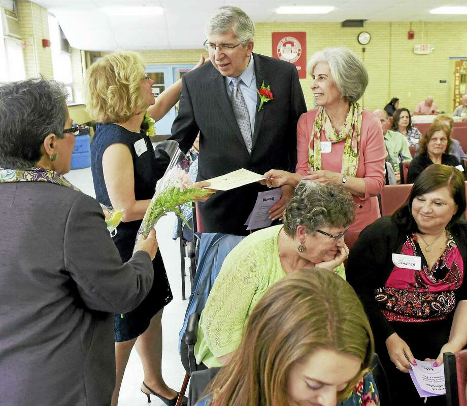 (Peter Hvizdak - New Haven Register)Lee Canning, Woodbridge Senior Center Director, left,  and Nancy Pfund, Woodbridge Youth Services Director, present Barry and Hyla Vine of Woodbridge an award of appreciation during the Town of Woodbridge  Twenty-eighth Annual Human Services Volunteer Tea at the senior center Thursday afternoon, April 28, 2016. Photo: ©2016 Peter Hvizdak / ©2016 Peter Hvizdak