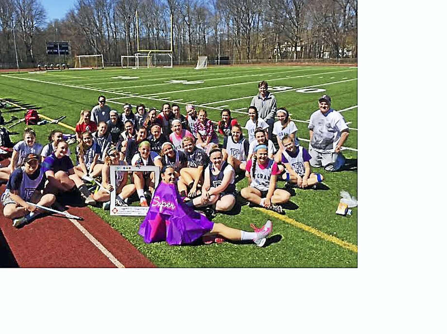 Joseph A. Foran High School lacrosse players recently played to raise money for Milford Prevention Council and they had the help of two sisters who lost another sister to heroin overdose. Contributed photo Photo: Journal Register Co.