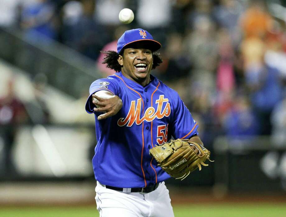 FILE - In this Wednesday, Sept. 10, 2014, file photo, New York Mets relief pitcher Jenrry Mejia tosses the ball to throw out Colorado Rockies' Josh Rutledge at first base to end a baseball game in New York. Mejia became the first player to receive a lifetime ban under baseball's drug agreement testing positive for a performance-enhancing substance for the third time. Mejia tested positive for Boldenone, the commissioner's office said Friday, Feb. 12, 2016. (AP Photo/Frank Franklin II, File) Photo: AP / AP