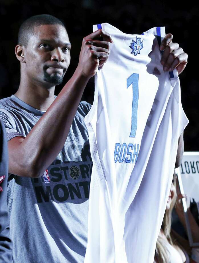 Miami Heat forward Chris Bosh holds  up a jersey for the NBA All-Star Game on Tuesday. Bosh will not participate due to a strained right calf. Photo: File Photo – The Associated Press   / AP